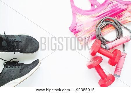 Creative flat lay of sport and fitness equipments on white background