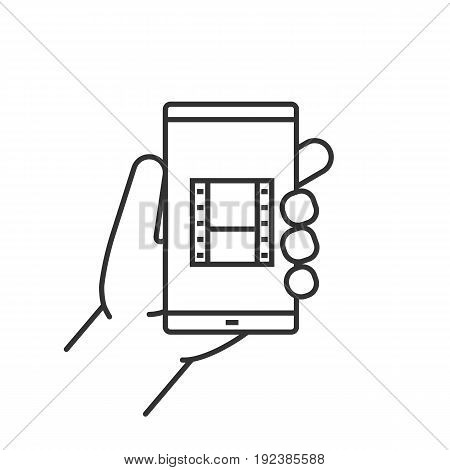 Hand holding smartphone linear icon. Thin line illustration. Smart phone video file contour symbol. Vector isolated outline drawing