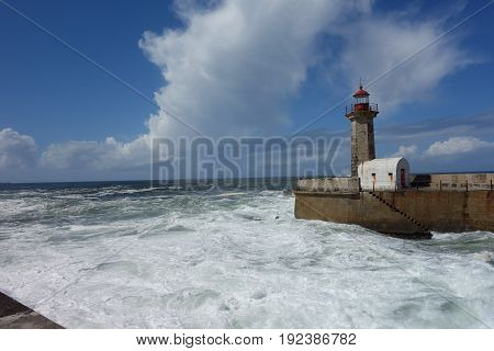 Lighthouse image with ocean waves in Porto