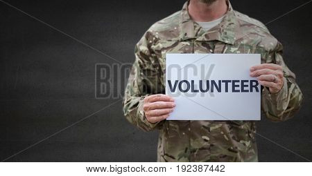 Digital composite of Soldier volunteer mid section against grey wall