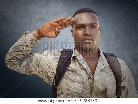 Digital composite of Soldier saluting against navy background with grunge overlay