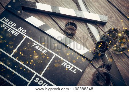 Movie clap clapper take action entertainment blue background