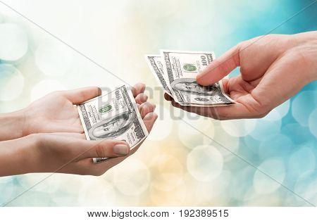 One hands dollars hundred dollar white background