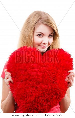 Woman blonde long hair girl holding red big heart love symbol studio shot isolated on white. Valentines day happiness concept