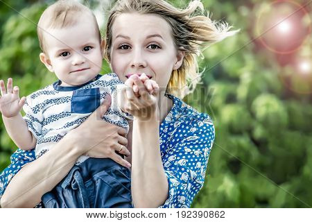 Beautiful happy mather with baby boy outdoor
