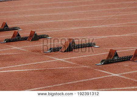 starting blocks on start line of running track stadium
