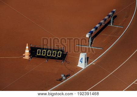 running track stadium with time scoreboard and barrier for steeplechase