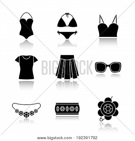 Women's accessories drop shadow black icons set. Clothes and jewelry. Swimsuits, top, t-shirt, skirt, sunglasses, bracelet, brooch, necklace. Isolated vector illustrations