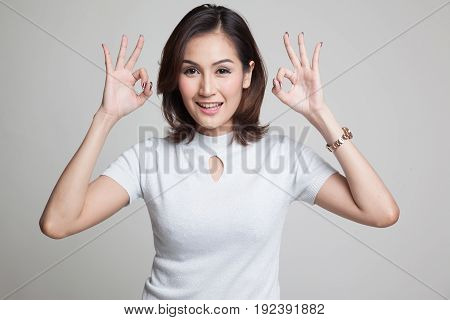 Asian Woman Show Double Ok Hand Sign  And Smile.