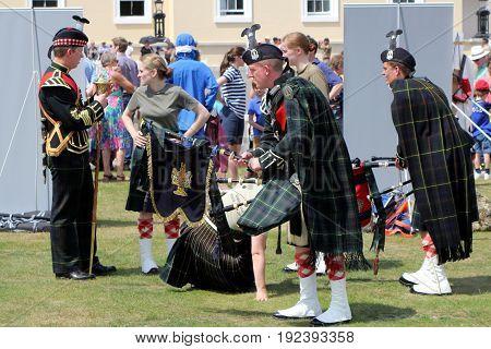 Sandhurst, Uk - June 18 2017: Members Of A Bagpipe Band Preparing To Perform