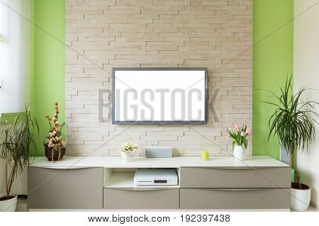 Modern living room interior - tv mounted on brick wall with white screen.