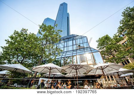 FRANKFURT, GERMANY - May 16, 2017: People having a lunch on the restaurant terrace in the building of Deutsche bank in Frankfurt city