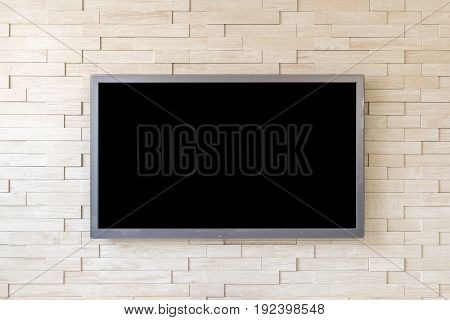 TV display on modern brick wall background with black screen.