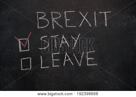 Brexit stay or leave written with white chalk on blackboard