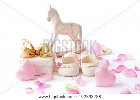 gift box and baby shoes. baby birth concept