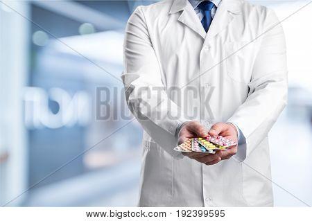 Holding male doctor tablet blister blisters pack