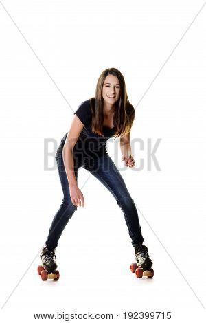 teen girl trying to roller skate on white
