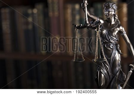 Law theme - court library, statue of justice, books.