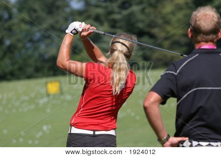 Lady Golf Swing Over The Leman Lake