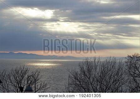 Sun through clouds under the sea in Vladivostok, Russia