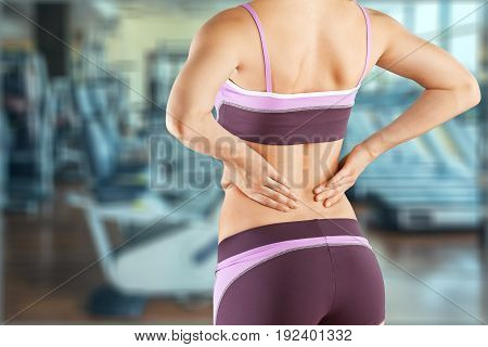 Woman pain muscle injury painful close up back pain