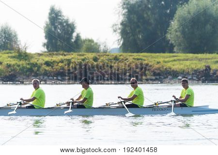 DEVENTER NETHERLANDS - AUGUST 27 2016: canoe with team of sports rowers on the dutch ijssel river