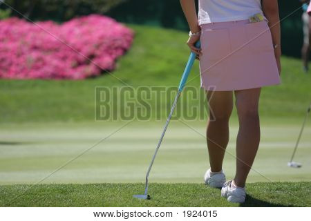 lady golf action on the putting green poster