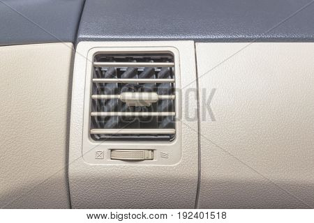 interior of modern car air vent with on/off switch