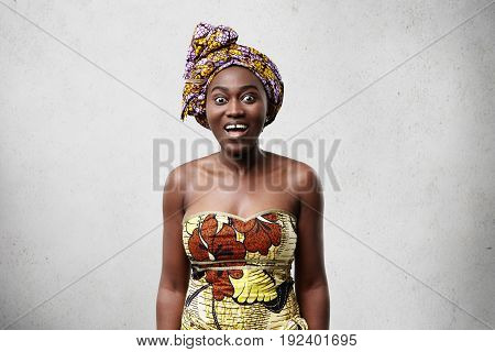 Horizontal Studio Shot Of Attractive Astonished Amazed African Female In Beautiful Traditional Ethni
