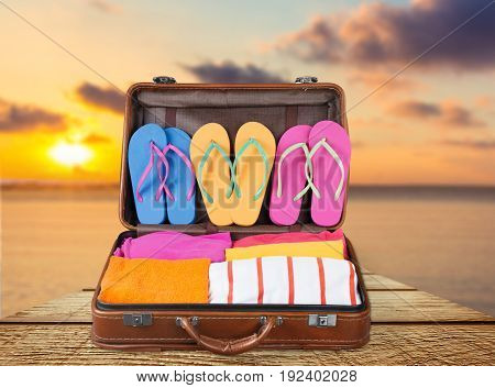 Leather case vacation suitcase stuff flip flops leisure