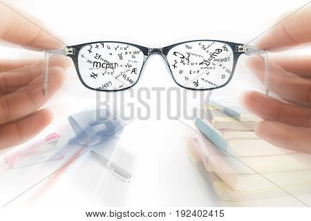 Two hands holding glasses use read book Education concept Magic glasses memory data concept Studying for exam