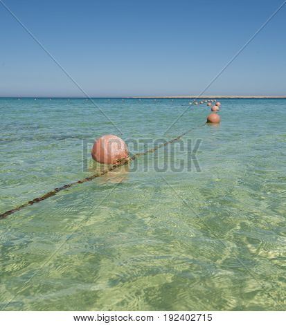 Floating Buoys On Rope In Tropical Ocean Lagoon