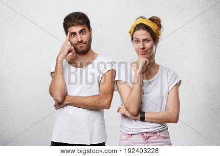 Female And Male Standing Near Each Other Having Pensive Expressions Trying To Find Solution. Two Bes