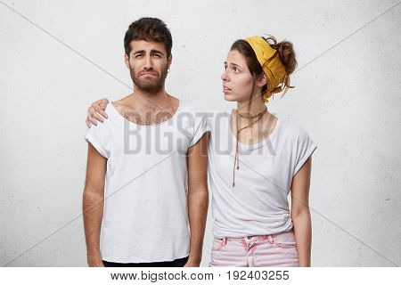 Caring And Compassionate Young Woman Looking At His Unhappy Depressed Crying Boyfrined With Worried