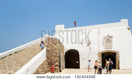 Tourists In Courtyard Of Fortress Of Sagres