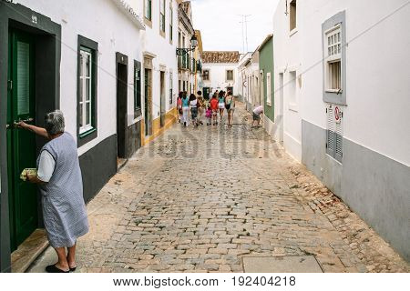 People On Typical Street In Center Of Faro City