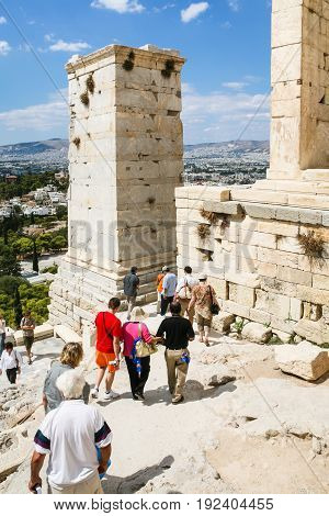 Tourists Near Propylaea Of The Athenian Acropolis