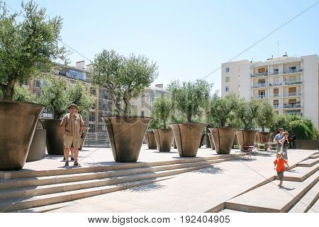 People In Garden On Street In Marseilles City