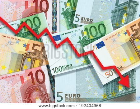 Euro money fall concept, arrow chart pointing down against background made of Euro bills