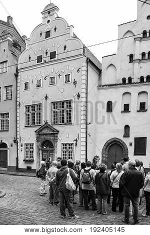Tourists On Maza Pils Street Near Medieval Houses