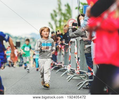 Handsome little 6 year old boy participating in 2 km marathon for children