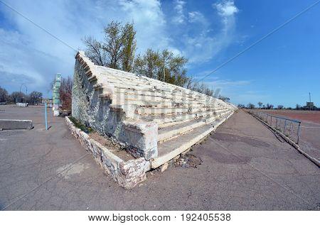 Abandoned stadium.Sary Shagan.Former Soviet  anti-ballistic missile testing range.Kazakhstan.May 6, 2017.Sary Shagan.Kazakhstan