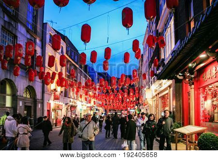 Visitors In China Town Decorated By Chinese Lanterns