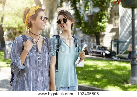 People And Relationships Concept. Sweet Couple Of Lesbians Walking Togehter Outdoor Looking At Each