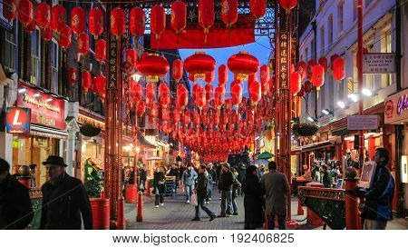 People In China Town Decorated By Chinese Lanterns