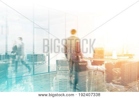 Business people are walking in a modern office with glass doors. Cityscape background. Concept of a business life. Mock up toned image double exposure