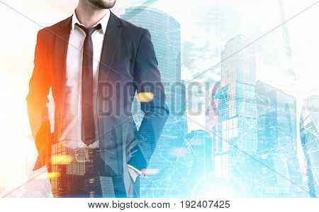 Bearded businessman wearing a black suit and standing with his hands in pockets against a foggy cityscape. Toned image mock up
