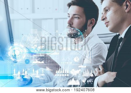 Close up of a young bearded businessman in a shirt and his blond colleague sitting in a white office and working. Toned image double exposure