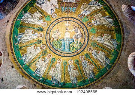 Ravenna Italy - March 1 2012: The mosaic of the dome of the Battistero Degli Ariani.