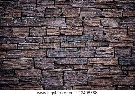 It is Dark brown brick wall for pattern